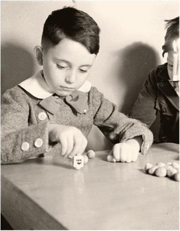 Yad Vashem Archives - Boy with Dreidel at Hanukkah