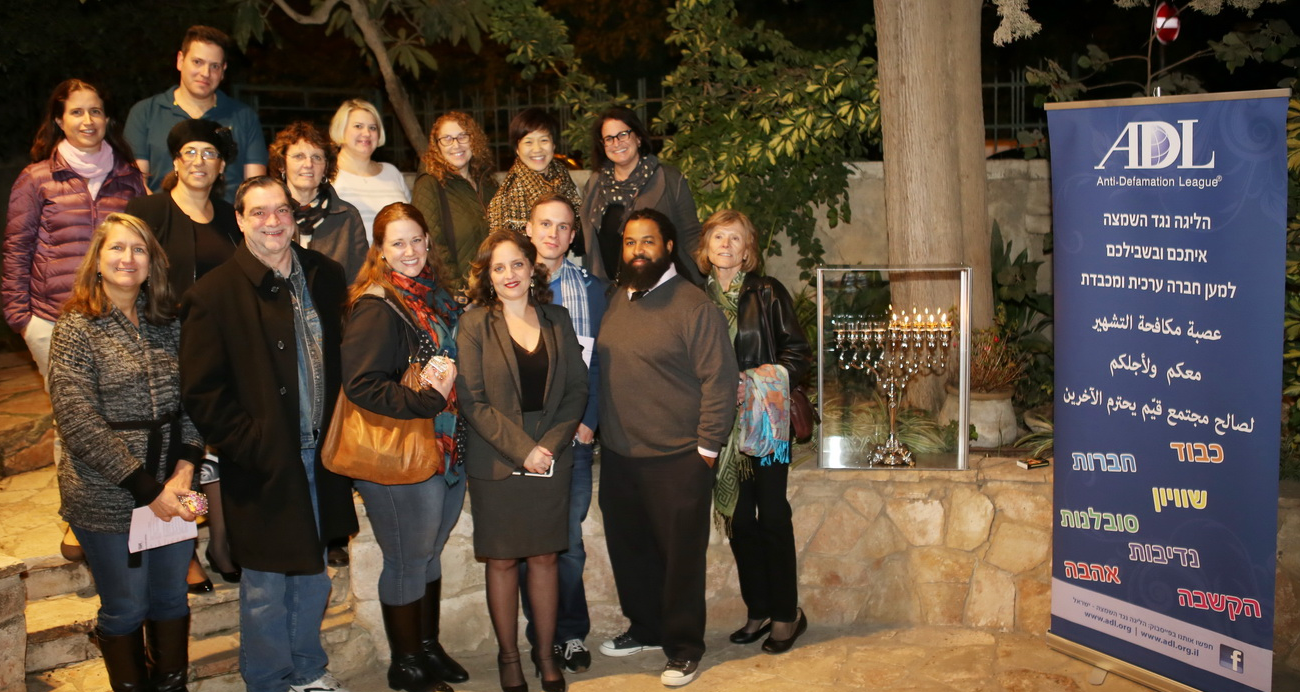 Echoes and Reflections Facilitators light Hanukkah candles at Yad Vashem - December 2015