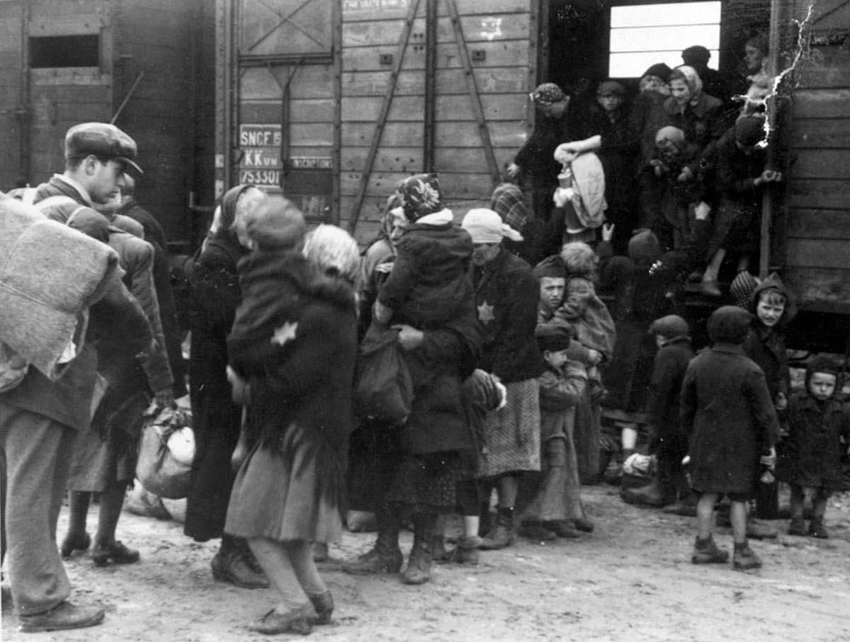 Image from the Auschwitz Album of Jews getting off a train at Auschwitz-Birkenau